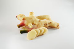 Ginger. Cut in slices on white Royalty Free Stock Image