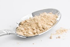 Ginger. Spoon full of ground ginger royalty free stock images