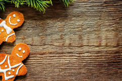 Ginger biscuits and a branches of a Christmas tree Stock Images