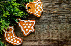 Ginger biscuits and a branches of a Christmas tree Royalty Free Stock Image
