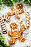 Ginger biscuits and a branches of a Christmas tree Stock Photography
