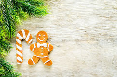 Ginger biscuits and a branches of a Christmas tree Royalty Free Stock Photography