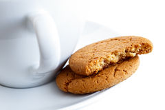 Ginger biscuits with cup and saucer. Royalty Free Stock Images