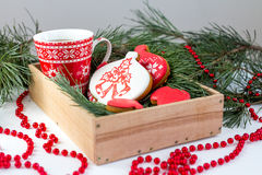 Ginger biscuits and a Cup of tea on the table with branches of s Stock Photo