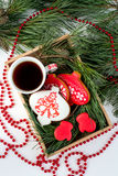 Ginger biscuits and a Cup of tea on the table with branches of s Stock Image