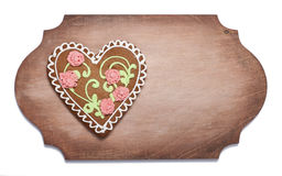Ginger biscuits in the form of heart on a wooden  shaped board Stock Photos