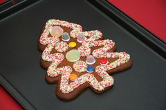 Ginger bread Christmas Tree. Beautifully decorated gingerbread Christmas Tree on a baking Tray Stock Image