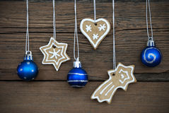 Ginger Bread Cookies and Christmas Balls on Wood Stock Images