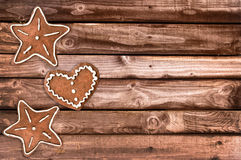 Ginger bread cookies and Christmas ornaments on wooden planks Royalty Free Stock Photos