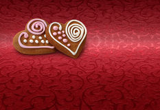 Ginger bread cookies on red Royalty Free Stock Images