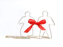 Ginger bread couple. Tied together with a red ribbon Royalty Free Stock Photos