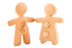Ginger-bread couple, boy and girl cakes together holding hands Stock Image