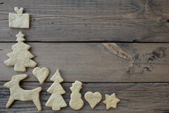 Ginger Bread Frame for Wooden Background. Some Ginger Bread Cookies as Frame on Wooden Planks as Background with Copy Space Royalty Free Stock Photos