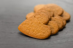 Ginger bread hearts on granite stone. Shallow depth of field Royalty Free Stock Photo
