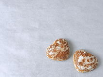 """Ginger bread hearts upon """"silver"""" background. Top view. Copy space for your text Stock Photos"""