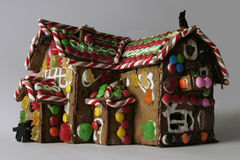 Ginger Bread House. A christmas ginger bread decoration house seen from a low vantage point with lots of candy on it Royalty Free Stock Photos