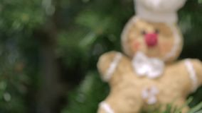 Ginger bread man toy decoration on a Christmas tree stock footage
