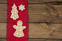 Ginger Bread on Red and Wooden Background Stock Images