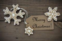 Ginger Bread Stars met Vrolijk Kerstmisetiket Stock Foto's