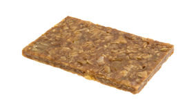 Ginger brittle bar on a white background side view Stock Photos