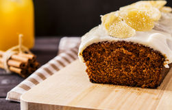 Ginger cake. With frosting cream cheese, decorated with candied ginger Stock Image