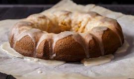 Ginger cake with lemon glaze. Ginger cake drizzled with lemon glaze on a dark wooden background Stock Photos