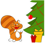 Ginger cat near with christmas tree Stock Image