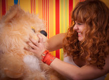 Ginger childish behavior teddy bear Stock Photography