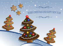 Ginger chocolate trees on snow background Royalty Free Stock Photography