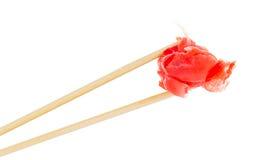 Ginger in chopsticks Royalty Free Stock Image
