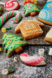 Ginger Christmas cookies, cane and candy strewn with snow Royalty Free Stock Image