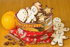 Ginger Christmas cookies in the red bag and spices. On the table Royalty Free Stock Photography