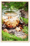 Ginger Christmas Cookies Stars in Kruik Retro Kader stock foto