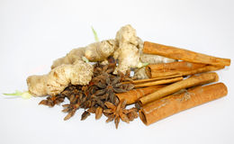 Ginger, cinnamon and star anise over white Royalty Free Stock Images