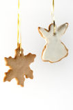 Ginger cookies. Hanging ginger cookies on a white background Royalty Free Stock Photos