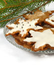 Ginger cookies. Decorated ginger cookies on a glass plate Royalty Free Stock Images