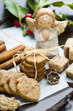 Ginger cookies and angel statuette. Christmas ginger cookies, holly ilex, spices and angel statuette stock photo