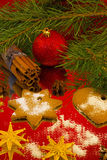 Ginger cookies with cinnamon and red round toy Royalty Free Stock Images