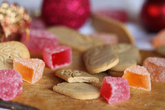 Ginger cookies and fruit jelly. Still life: ginger cookies, fruit jelly and Christmas balls royalty free stock photography