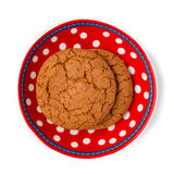 Ginger cookies on red white dotted dish isolated on white backgr Stock Photography