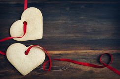 Ginger cookies in the shape of hearts on wooden background Stock Images