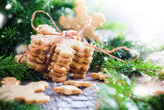 Ginger Cookies Snowflakes tied up by a Rope. Drawn Snow Royalty Free Stock Photo