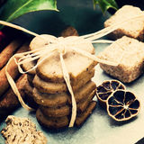 Ginger cookies and spices. Ginger cookies, holly ilex and spices close up stock photos