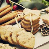 Ginger cookies and spices. Ginger cookies, holly ilex and spices close up royalty free stock photo