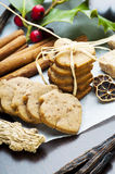Ginger cookies and spices. Ginger cookies, holly ilex and spices close up stock image
