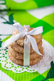 Ginger cookies tied with white ribbon Royalty Free Stock Images