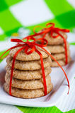 Ginger cookies on white plate. Stacks of ginger cookies tied with red ribbon on white plate Stock Image