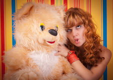 Ginger curly young teen girl clown teddy bear Royalty Free Stock Photography