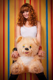 Ginger curly young teen girl teddy bear Royalty Free Stock Photography