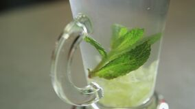 Ginger drink close up. Mixing lemon, mint, ginger, water and sugar Close up stock footage